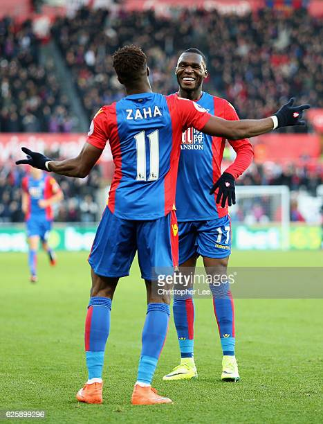 Wilfried Zaha of Crystal Palace celebrates scoring the opening goal with his team mate Christian Benteke during the Premier League match between...