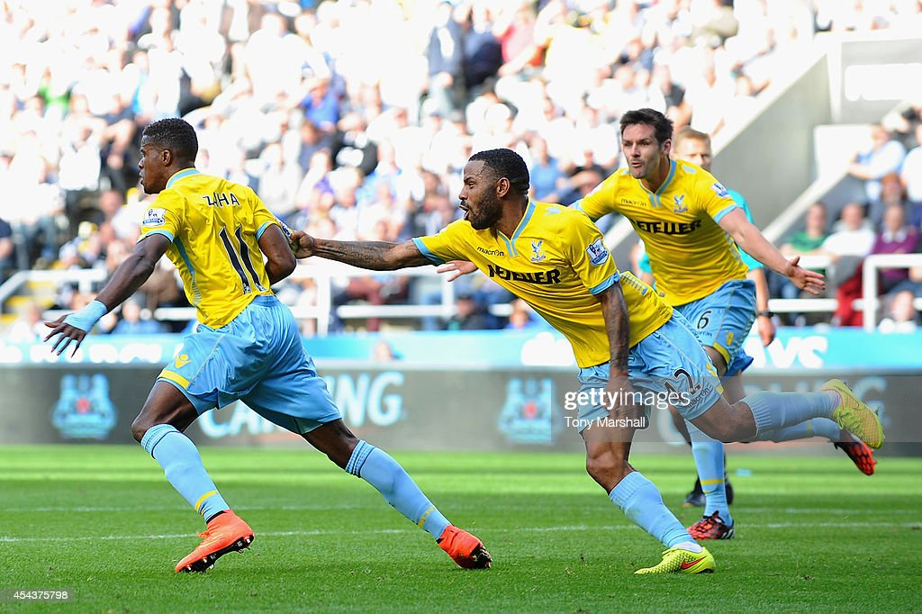 Wilfried Zaha of Crystal Palace celebrates scoring third goal with Jason Puncheon during the Barclays Premier League match between Newcastle United and Crystal Palace at St James' Park on August 30, 2014 in Newcastle upon Tyne, England.
