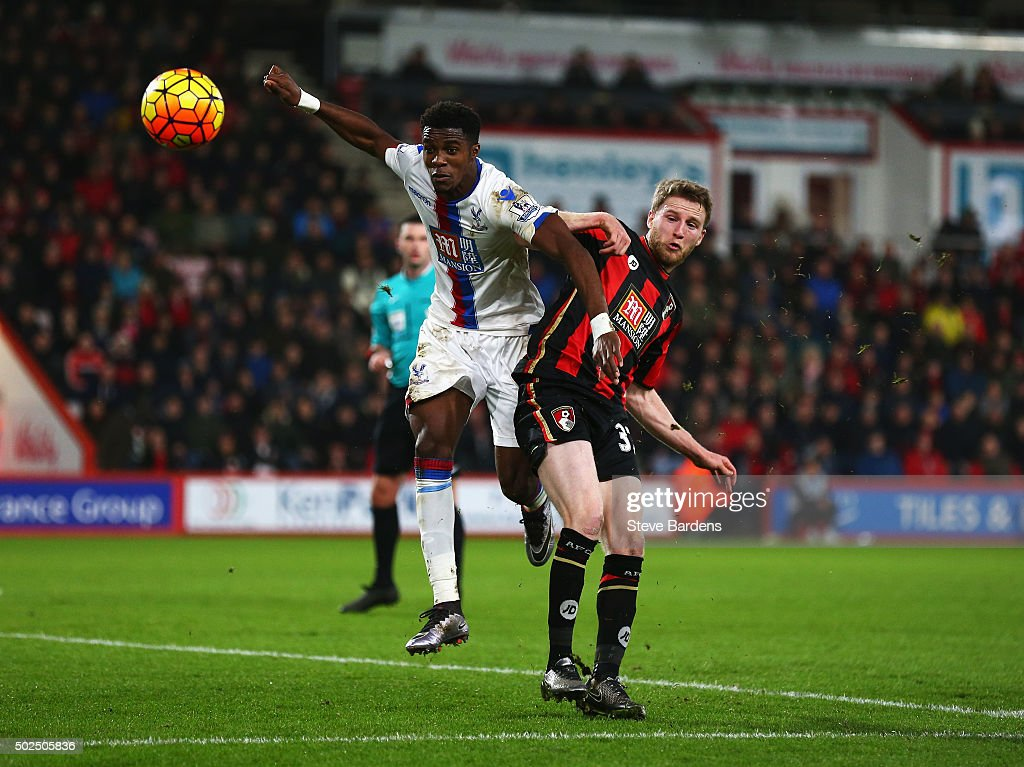 Wilfried Zaha of Crystal Palace challenges Eunan O'Kane of Bournemouth during the Barclays Premier League match between A.F.C. Bournemouth and Crystal Palace at Vitality Stadium on December 26, 2015 in Bournemouth, England.