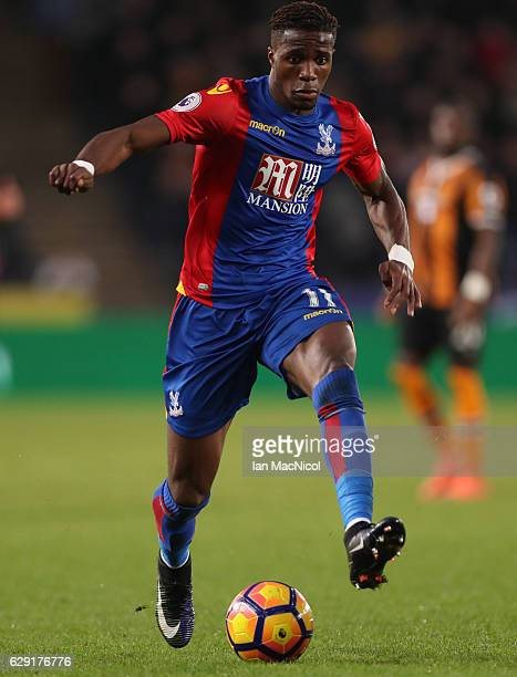 Wilfried Zaha of Crystal Palace controls the ball during the Premier League match between Hull City and Crystal Palace at KC Stadium on December 10...
