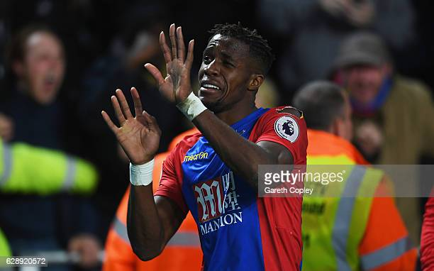Wilfried Zaha of Crystal Palace dances in celebration as he scores their second goal during the Premier League match between Hull City and Crystal...