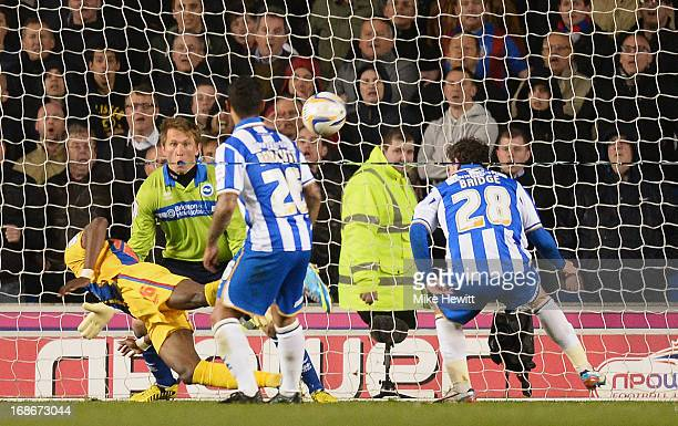 Wilfried Zaha of Crystal Palace heads past Tomasz Kuszczak of Brighton to score during the npower Championship Play Off Semi Final Second Leg between...