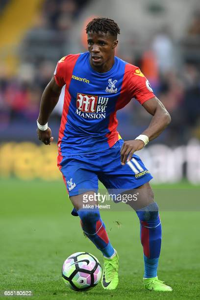 Wilfried Zaha of Crystal Palace in action during the Premier League match between Crystal Palace and Watford at Selhurst Park on March 18 2017 in...