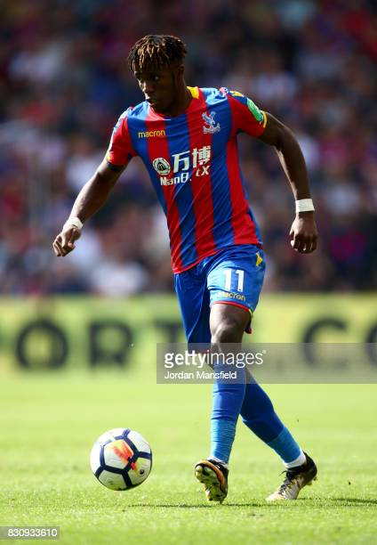 Wilfried Zaha of Crystal Palace in action during the Premier League match between Crystal Palace and Huddersfield Town at Selhurst Park on August 12...