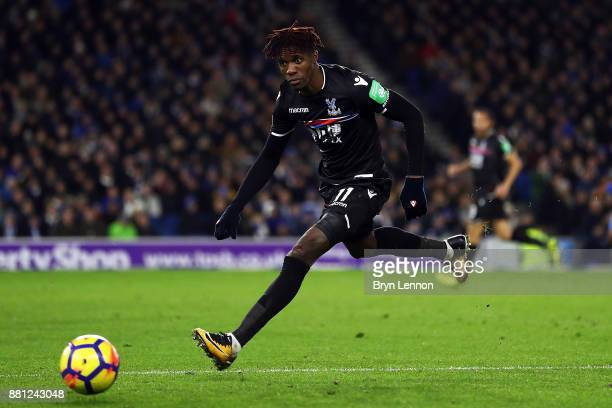 Wilfried Zaha of Crystal Palace in action during the Premier League match between Brighton and Hove Albion and Crystal Palace at Amex Stadium on...