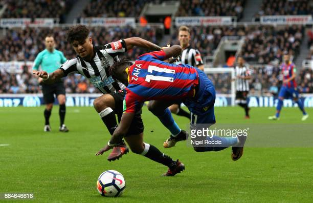 Wilfried Zaha of Crystal Palace is challenged by Deandre Yedlin of Newcastle United during the Premier League match between Newcastle United and...
