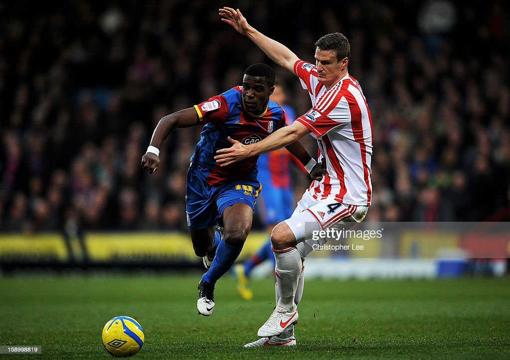 <a gi-track='captionPersonalityLinkClicked' href=/galleries/search?phrase=Wilfried+Zaha&family=editorial&specificpeople=7132531 ng-click='$event.stopPropagation()'>Wilfried Zaha</a> of Crystal Palace is challenged by <a gi-track='captionPersonalityLinkClicked' href=/galleries/search?phrase=Robert+Huth&family=editorial&specificpeople=206878 ng-click='$event.stopPropagation()'>Robert Huth</a> of Stoke during the FA Cup with Budweiser Third Round match between Crystal Palace and Stoke City at Selhurst Park on January 5, 2013 in London, England.