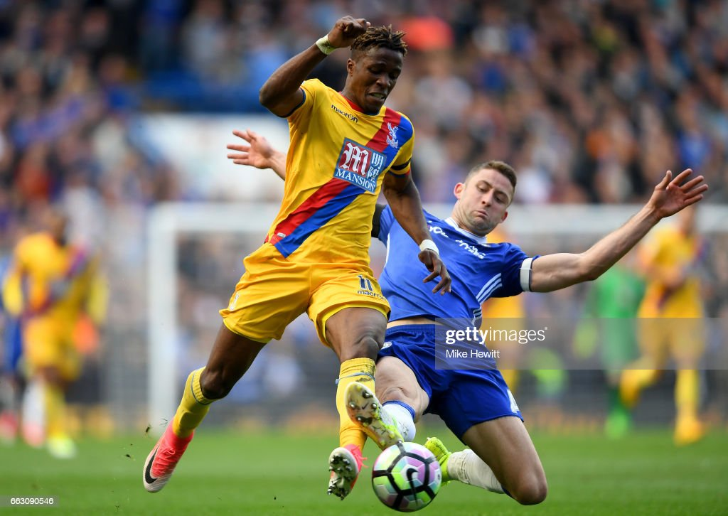 Wilfried Zaha of Crystal Palace (L) is tackled by Gary Cahill of Chelsea (R) during the Premier League match between Chelsea and Crystal Palace at Stamford Bridge on April 1, 2017 in London, England.