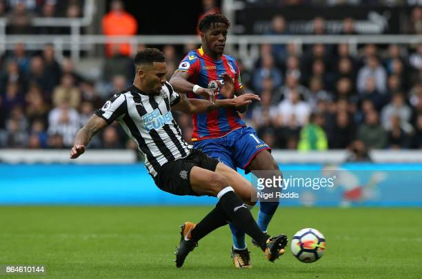 Wilfried Zaha of Crystal Palace is tackled by Jamaal Lascelles of Newcastle United during the Premier League match between Newcastle United and...