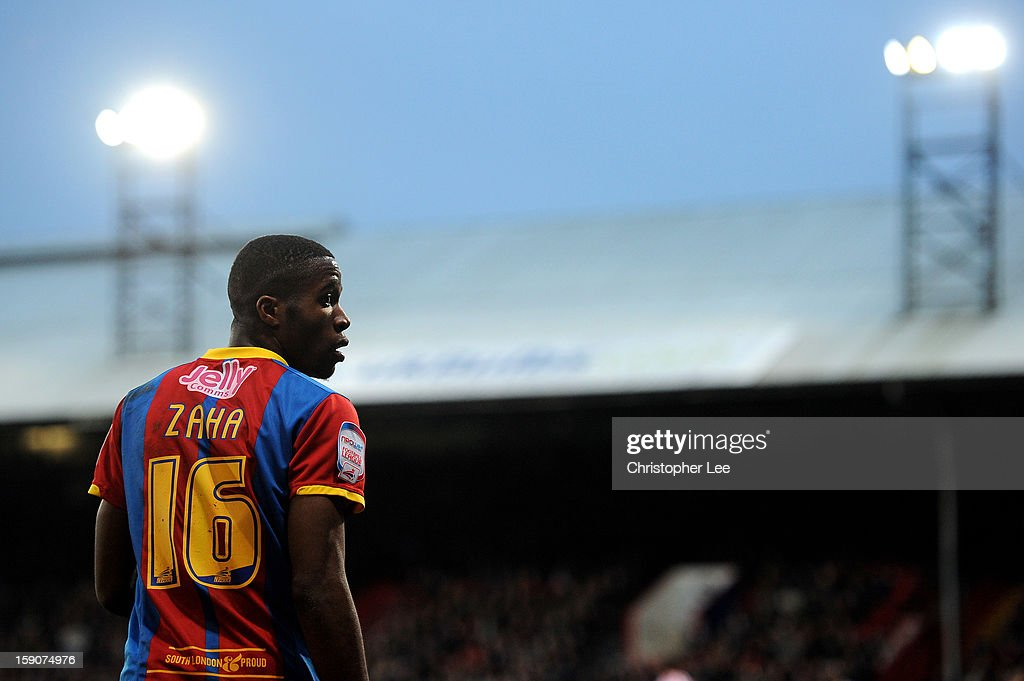 <a gi-track='captionPersonalityLinkClicked' href=/galleries/search?phrase=Wilfried+Zaha&family=editorial&specificpeople=7132531 ng-click='$event.stopPropagation()'>Wilfried Zaha</a> of Crystal Palace looks on during the FA Cup with Budweiser Third Round match between Crystal Palace and Stoke City at Selhurst Park on January 5, 2013 in London, England.