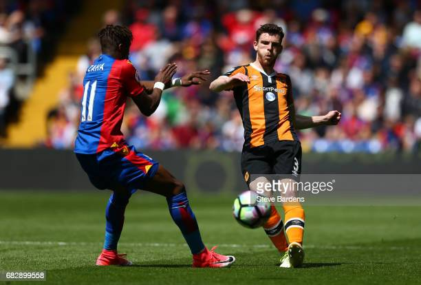 Wilfried Zaha of Crystal Palace puts pressure on Andrew Robertson of Hull City during the Premier League match between Crystal Palace and Hull City...