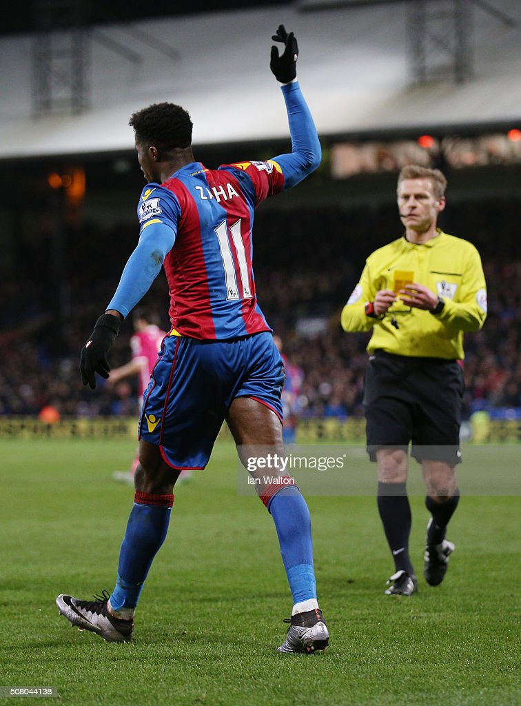 <a gi-track='captionPersonalityLinkClicked' href=/galleries/search?phrase=Wilfried+Zaha&family=editorial&specificpeople=7132531 ng-click='$event.stopPropagation()'>Wilfried Zaha</a> of Crystal Palace reacts as referee <a gi-track='captionPersonalityLinkClicked' href=/galleries/search?phrase=Mike+Jones+-+%C3%81rbitro&family=editorial&specificpeople=7275880 ng-click='$event.stopPropagation()'>Mike Jones</a> prepares for an yellow card during the Barclays Premier League match between Crystal Palace and A.F.C. Bournemouth at Selhurst Park on February 2, 2016 in London, England.