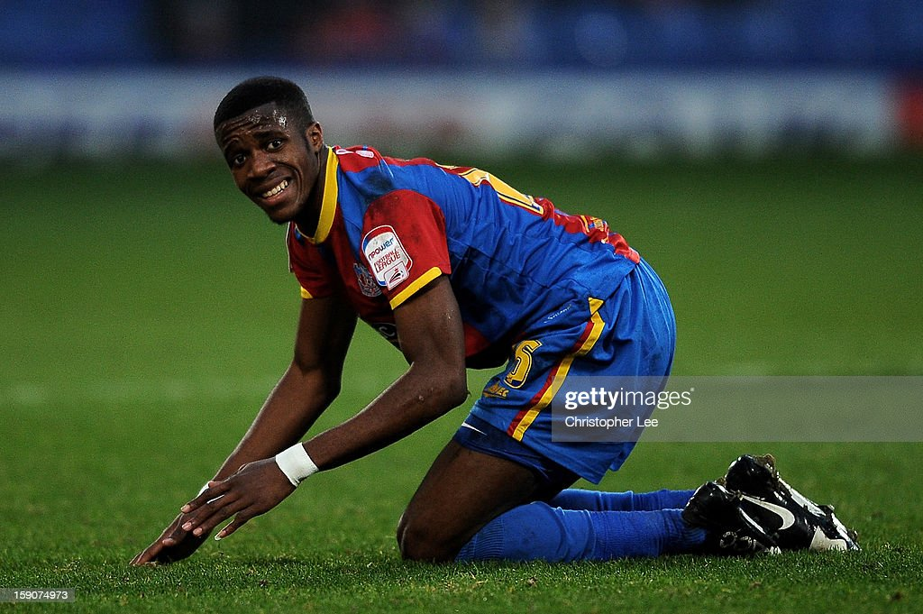 <a gi-track='captionPersonalityLinkClicked' href=/galleries/search?phrase=Wilfried+Zaha&family=editorial&specificpeople=7132531 ng-click='$event.stopPropagation()'>Wilfried Zaha</a> of Crystal Palace reacts during the FA Cup with Budweiser Third Round match between Crystal Palace and Stoke City at Selhurst Park on January 5, 2013 in London, England.