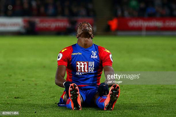 Wilfried Zaha of Crystal Palace reacts during the Premier League match between Swansea City and Crystal Palace at Liberty Stadium on November 26 2016...