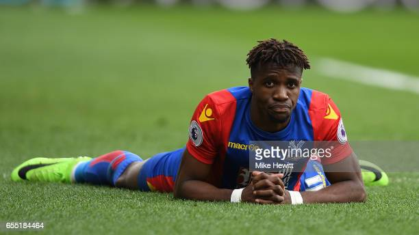 Wilfried Zaha of Crystal Palace reacts during the Premier League match between Crystal Palace and Watford at Selhurst Park on March 18 2017 in London...