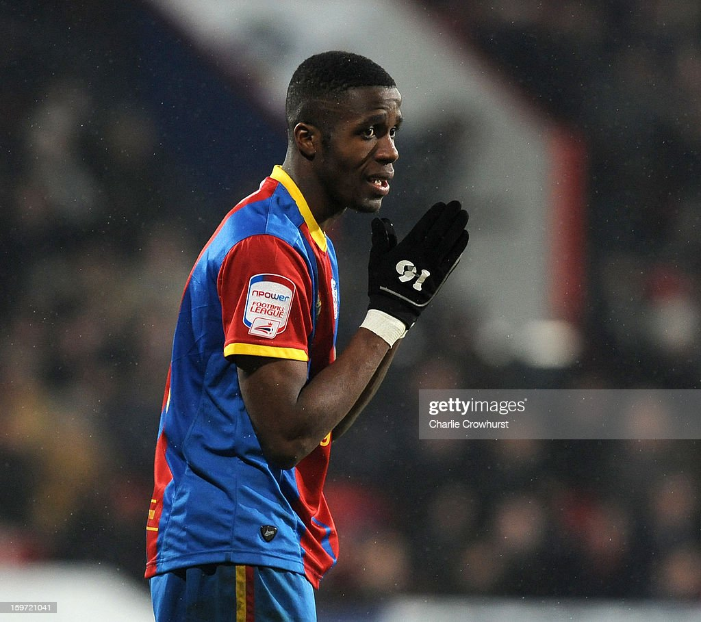 <a gi-track='captionPersonalityLinkClicked' href=/galleries/search?phrase=Wilfried+Zaha&family=editorial&specificpeople=7132531 ng-click='$event.stopPropagation()'>Wilfried Zaha</a> of Crystal Palace reacts to going close to goal during the npower Championship match between Crystal Palace and Bolton at Selhurst Park on January 19, 2013 in London England.