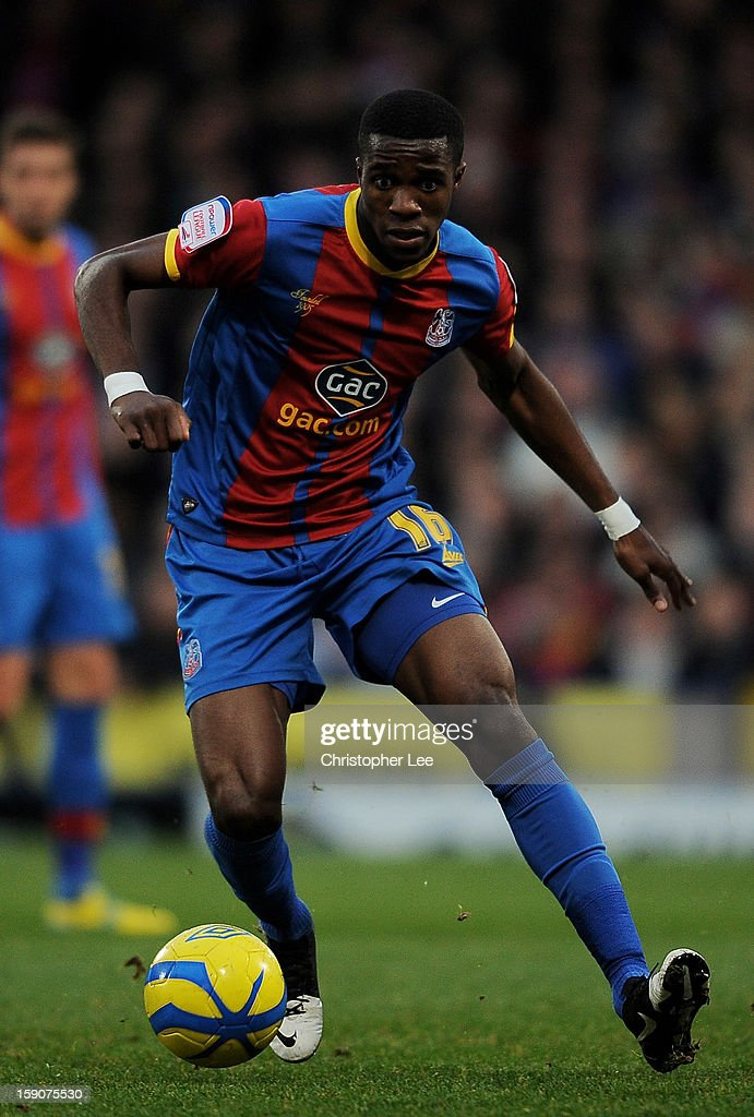 <a gi-track='captionPersonalityLinkClicked' href=/galleries/search?phrase=Wilfried+Zaha&family=editorial&specificpeople=7132531 ng-click='$event.stopPropagation()'>Wilfried Zaha</a> of Crystal Palace runs with the ball during the FA Cup with Budweiser Third Round match between Crystal Palace and Stoke City at Selhurst Park on January 5, 2013 in London, England.