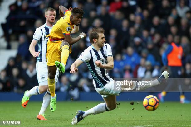 Wilfried Zaha of Crystal Palace scores his sides first goal during the Premier League match between West Bromwich Albion and Crystal Palace at The...