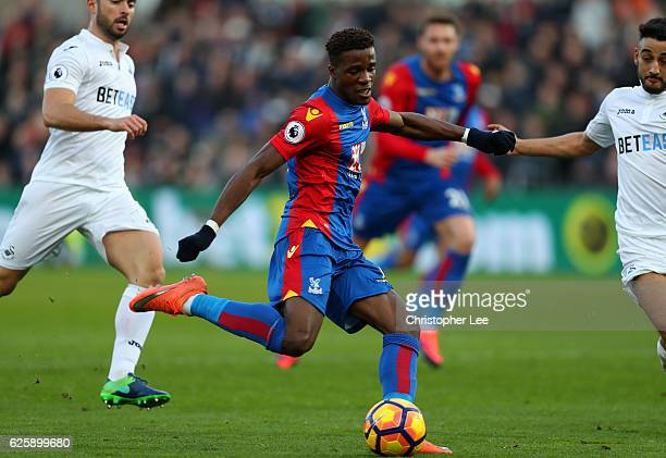 Wilfried Zaha of Crystal Palace scores the opening goal during the Premier League match between Swansea City and Crystal Palace at Liberty Stadium on...