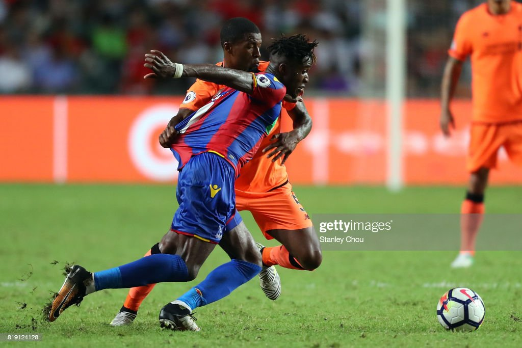 Wilfried Zaha of Crystal Palace shields the ball away from Georginio Wijnaldum of Liverpool during the Premier League Asia Trophy match between Liverpool and Crystal Palace at Hong Kong Stadium on July 19, 2017 in Hong Kong, Hong Kong.