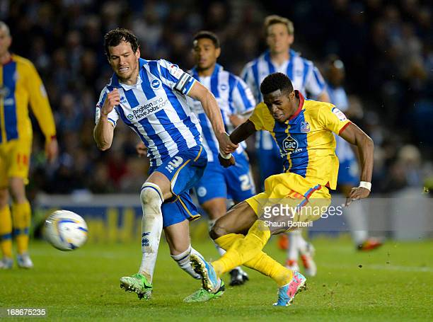 Wilfried Zaha of Crystal Palace shoots past Gordon Greer of Brighton Hove Albion to score his second goal during the npower Championship play off...