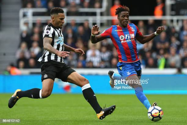 Wilfried Zaha of Crystal Palace takes on Jamaal Lascelles of Newcastle United during the Premier League match between Newcastle United and Crystal...