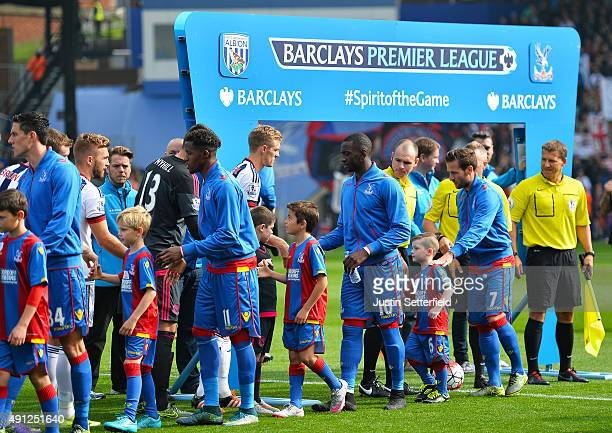 Wilfried Zaha of Crystal Palace Yannick Bolasie of Crystal Palace and Yohan Cabaye of Crystal Palace shake hands ahead of the Barclays Premier League...