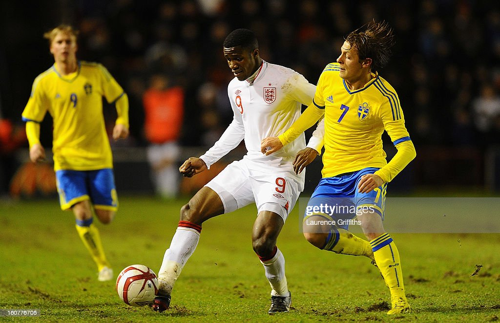 <a gi-track='captionPersonalityLinkClicked' href=/galleries/search?phrase=Wilfried+Zaha&family=editorial&specificpeople=7132531 ng-click='$event.stopPropagation()'>Wilfried Zaha</a> of England battles battles with Joel Allansson of Sweden during the U-21 International match between England U-21 and Sweden U-21 at Banks' Stadium on February 5, 2013 in Walsall, England.
