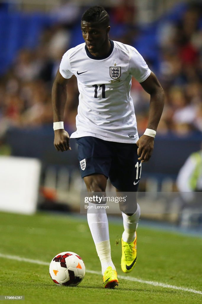 <a gi-track='captionPersonalityLinkClicked' href=/galleries/search?phrase=Wilfried+Zaha&family=editorial&specificpeople=7132531 ng-click='$event.stopPropagation()'>Wilfried Zaha</a> of England in action during the 2015 UEFA European U21 Championships Qualifier between England U21 and Moldova U21 at the Madejski Stadium on September 5, 2013 in Reading, England.