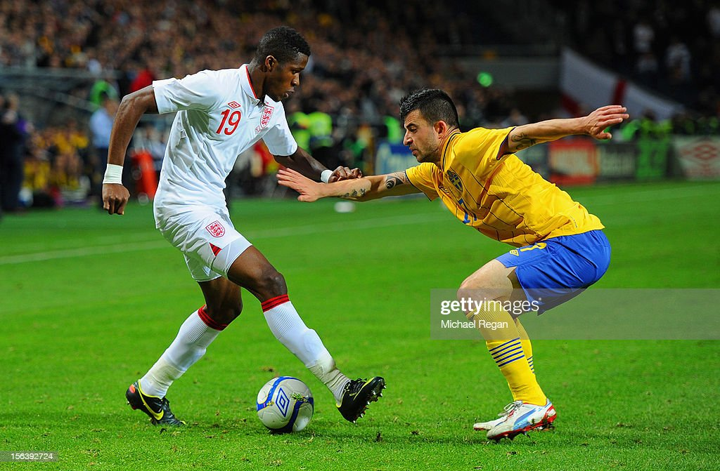 <a gi-track='captionPersonalityLinkClicked' href=/galleries/search?phrase=Wilfried+Zaha&family=editorial&specificpeople=7132531 ng-click='$event.stopPropagation()'>Wilfried Zaha</a> of England in action with Behrangt Safari of Sweden during the international friendly match between Sweden and England at the Friends Arena on November 14, 2012 in Stockholm, Sweden.