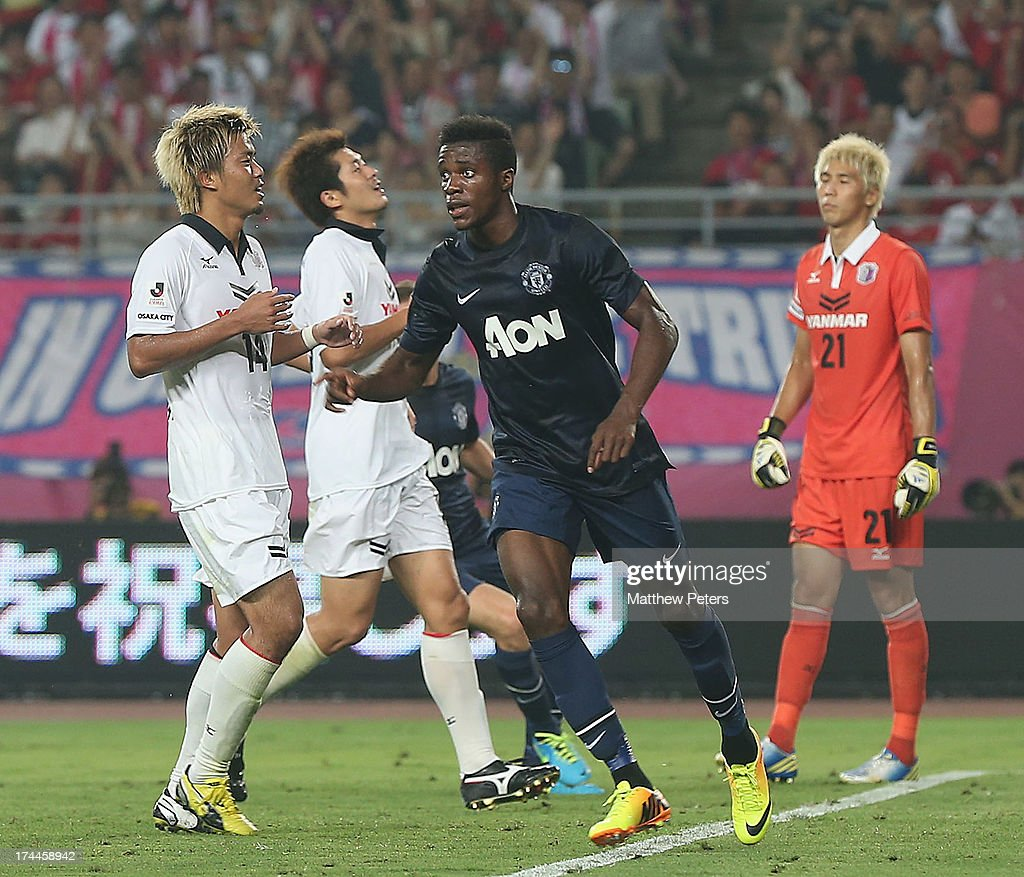 <a gi-track='captionPersonalityLinkClicked' href=/galleries/search?phrase=Wilfried+Zaha&family=editorial&specificpeople=7132531 ng-click='$event.stopPropagation()'>Wilfried Zaha</a> of Manchester United celebrates scoring their second goal during the pre-season friendly match between Cerezo Osaka and Manchester United as part of their pre-season tour of Bangkok, Australia, Japan and Hong Kong at Nagai Stadium on July 26, 2013 in Osaka, Japan.