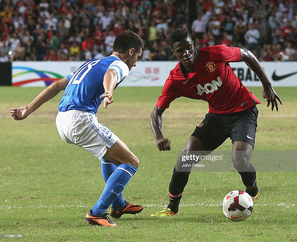 Wilfried Zaha of Manchester United in action with Jordi Tarres of Kitchee FC during the pre-season friendly match between Kitchee FC and Manchester United as part of their pre-season tour of Bangkok, Australia, Japan and Hong Kong at Hong Kong Stadium on July 29, 2013 in So Kon Po, Hong Kong.