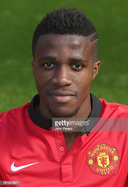 Wilfried Zaha of Manchester United poses at the annual club photocall at Old Trafford on September 26 2013 in Manchester England