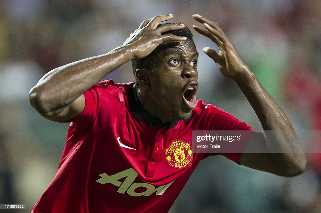 Wilfried Zaha of Manchester United reacts after missing an opportunity to score during the international friendly match between Kitchee FC and Manchester United at Hong Kong Stadium on July 29, 2013 in So Kon Po, Hong Kong.