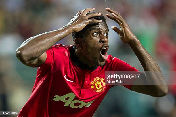 Wilfried Zaha of Manchester United reacts after missing an opportunity to score during the international friendly match between Kitchee FC and...