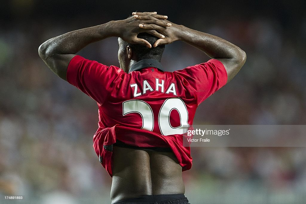 <a gi-track='captionPersonalityLinkClicked' href=/galleries/search?phrase=Wilfried+Zaha&family=editorial&specificpeople=7132531 ng-click='$event.stopPropagation()'>Wilfried Zaha</a> of Manchester United reacts after missing an opportunity to score during the international friendly match between Kitchee FC and Manchester United at Hong Kong Stadium on July 29, 2013 in So Kon Po, Hong Kong.