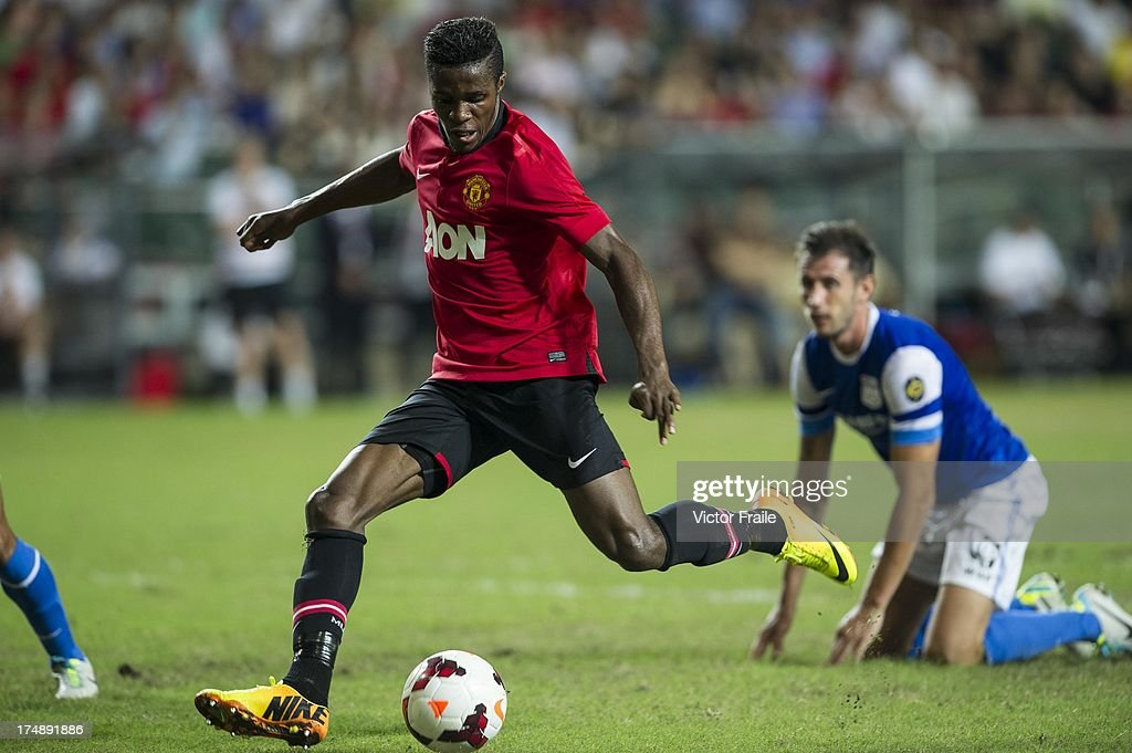 Wilfried Zaha of Manchester United runs with the ball during the international friendly match between Kitchee FC and Manchester United at Hong Kong Stadium on July 29, 2013 in So Kon Po, Hong Kong.