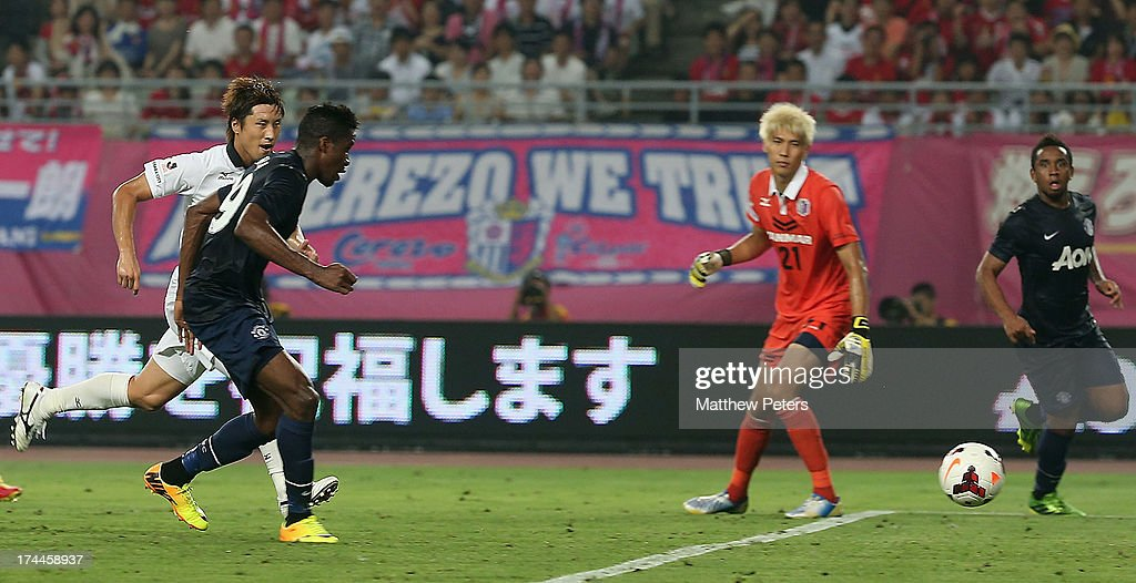 <a gi-track='captionPersonalityLinkClicked' href=/galleries/search?phrase=Wilfried+Zaha&family=editorial&specificpeople=7132531 ng-click='$event.stopPropagation()'>Wilfried Zaha</a> of Manchester United scores their second goal during the pre-season friendly match between Cerezo Osaka and Manchester United as part of their pre-season tour of Bangkok, Australia, Japan and Hong Kong at Nagai Stadium on July 26, 2013 in Osaka, Japan.