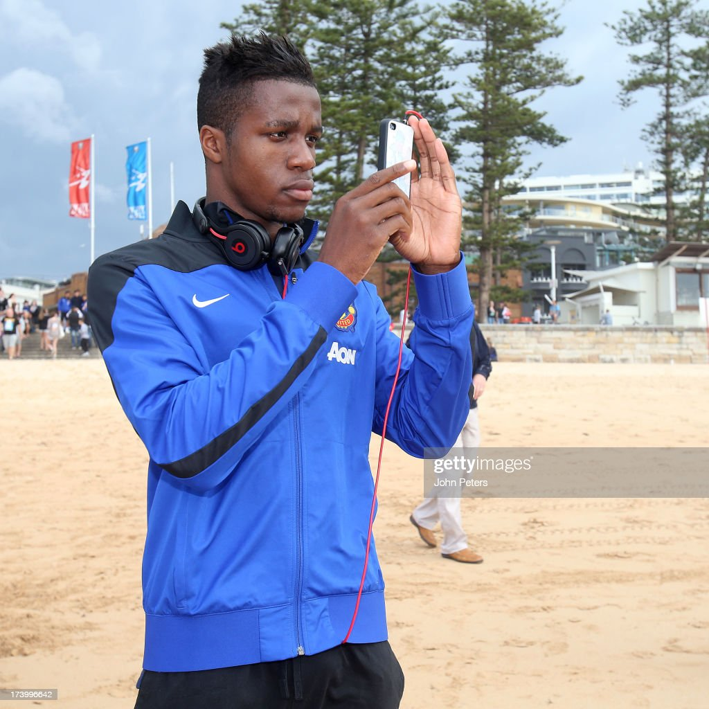 <a gi-track='captionPersonalityLinkClicked' href=/galleries/search?phrase=Wilfried+Zaha&family=editorial&specificpeople=7132531 ng-click='$event.stopPropagation()'>Wilfried Zaha</a> of Manchester United visits Manley Beach as part of their pre-season tour of Bangkok, Australia, China, Japan and Hong Kong on July 19, 2013 in Sydney, Australia.