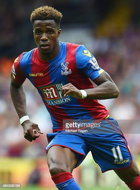 Wilfried Zaha of Palace in action during the Barclays Premier League match between Crystal Palace and Arsenal on August 16 2015 in London United...