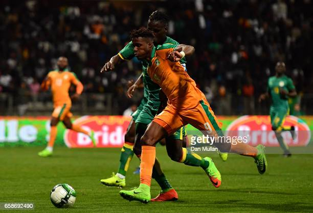 Wilfried Zaha of the Ivory Coast holds off Kara Mbodj of Senegal during the International Friendly match between the Ivory Coast and Senegal at the...