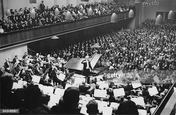 Wilhelm Furtwaengler is conducting the fifth Symphonic concert at Lucerne Festival In the foreground the pianist Edwin Fischer About 1955 Photograph