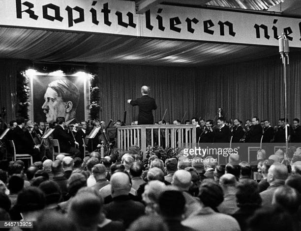 Wilhelm Furtwängler conducting a concert during a recreational break at the engeneering works R Stock Co in Berlin Marienfelde