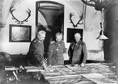'Wilhelm II German Emperor and king of Prussia with Paul von Hindenburg and Erich Ludendorff at the military headquarters in Spa looking at the...