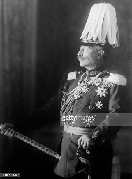 Wilhelm II German Emperor from 1888 to 1918 Threequarter length portrait standing in military uniform facing left with plumed helmet and holding a...