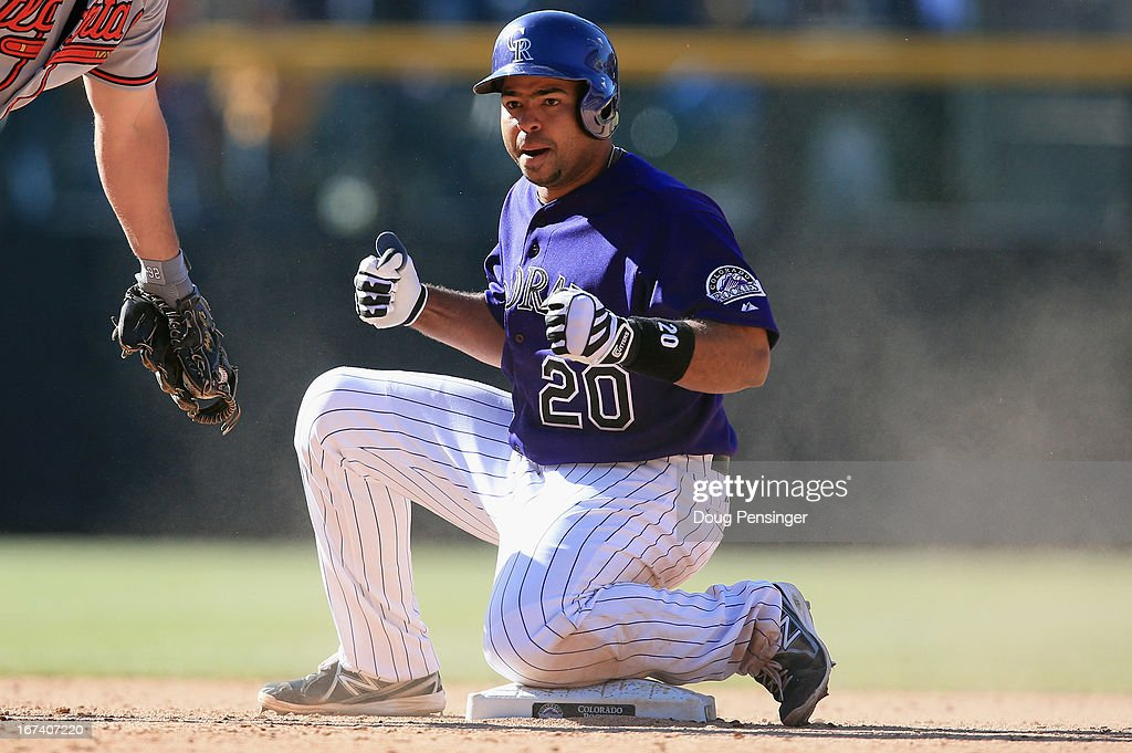 <a gi-track='captionPersonalityLinkClicked' href=/galleries/search?phrase=Wilin+Rosario&family=editorial&specificpeople=5734314 ng-click='$event.stopPropagation()'>Wilin Rosario</a> #20 of the Colorado Rockies celebrates his double against the Atlanta Braves in the bottom of the 12th inning at Coors Field on April 24, 2013 in Denver, Colorado. Rosario would go on to score the game winning run as the Rockies defeated the Braves 6-5 in 12 innings.