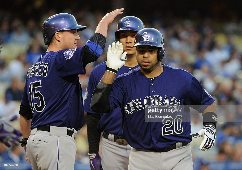 <a gi-track='captionPersonalityLinkClicked' href=/galleries/search?phrase=Wilin+Rosario&family=editorial&specificpeople=5734314 ng-click='$event.stopPropagation()'>Wilin Rosario</a> #20 of the Colorado Rockies celebrates with teammate <a gi-track='captionPersonalityLinkClicked' href=/galleries/search?phrase=Jordan+Pacheco&family=editorial&specificpeople=6889136 ng-click='$event.stopPropagation()'>Jordan Pacheco</a> #15 after hitting a three run homerun in the first inning against the Los Angeles Dodgers at Dodger Stadium on April 29, 2013 in Los Angeles, California.