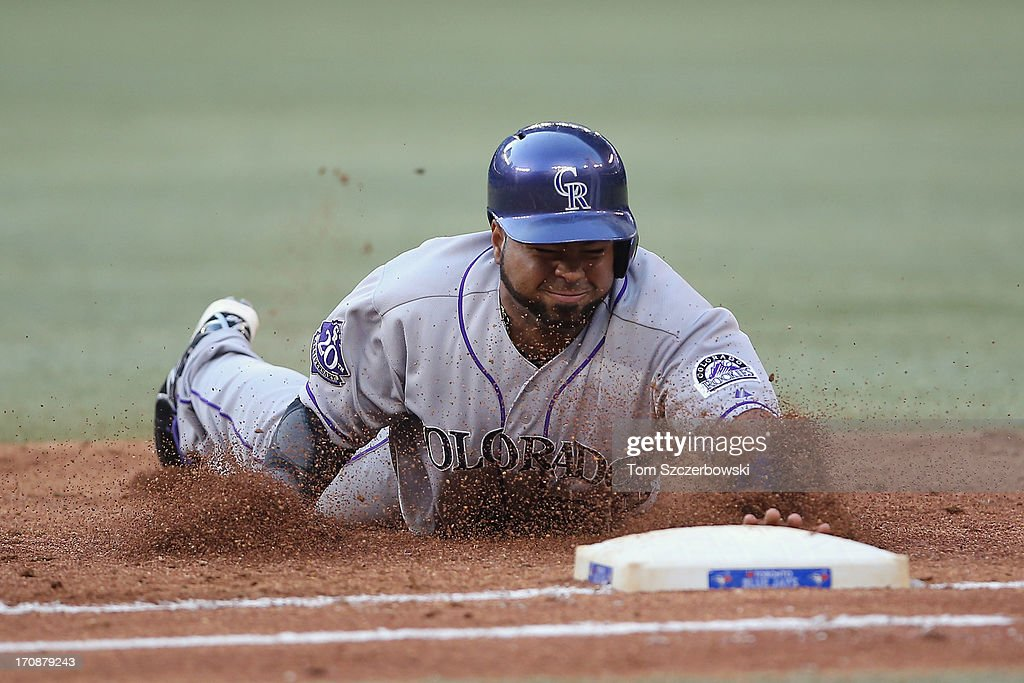 <a gi-track='captionPersonalityLinkClicked' href=/galleries/search?phrase=Wilin+Rosario&family=editorial&specificpeople=5734314 ng-click='$event.stopPropagation()'>Wilin Rosario</a> #20 of the Colorado Rockies dives back to first base to avoid being doubled off in the third inning during MLB game action against the Toronto Blue Jays on June 19, 2013 at Rogers Centre in Toronto, Ontario, Canada.