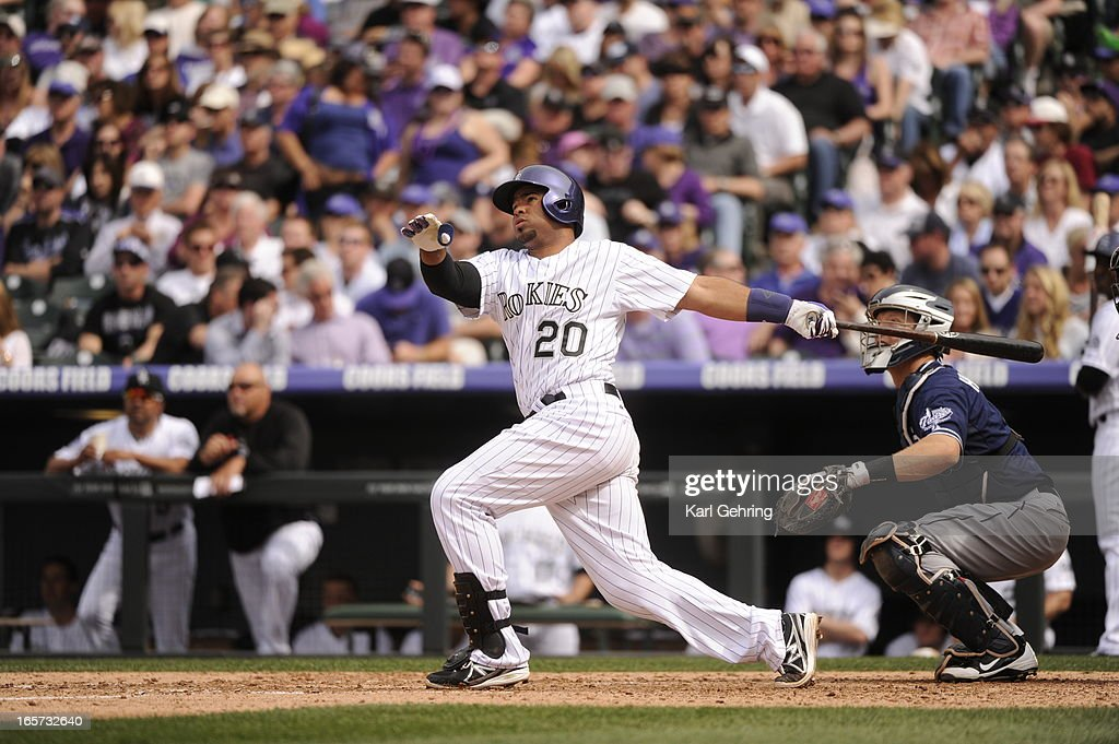 Wilin Rosario (20) of the Colorado Rockies hits a home run in the fourth inning. The Colorado Rockies took on the San Diego Padres on Opening Day at Coors Field in Denver, Colorado.