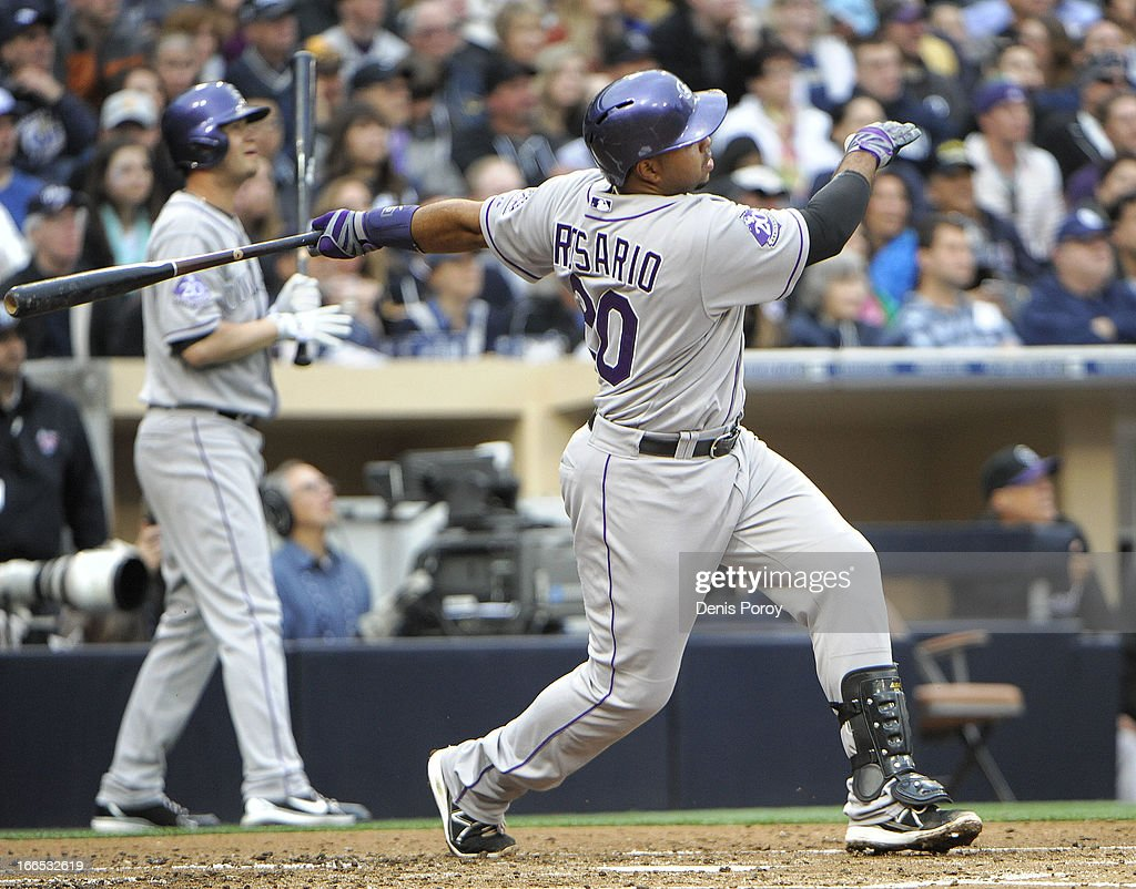 <a gi-track='captionPersonalityLinkClicked' href=/galleries/search?phrase=Wilin+Rosario&family=editorial&specificpeople=5734314 ng-click='$event.stopPropagation()'>Wilin Rosario</a> #20 of the Colorado Rockies hits a two-run homer during the second inning of a baseball game against the San Diego Padres at Petco Park on April 13, 2013 in San Diego, California.